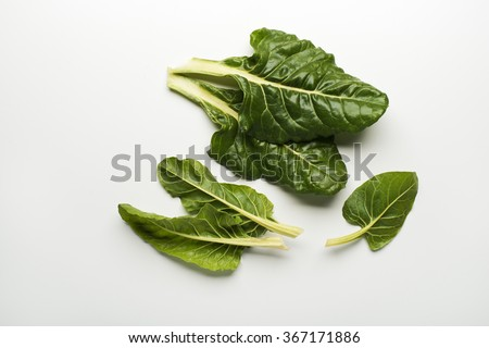 Fresh swiss chard leaves isolated on a white background.