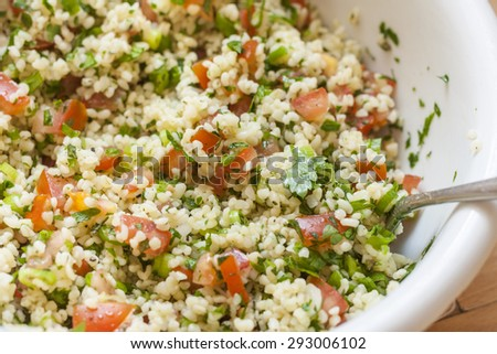 Fresh tabbouleh, a Middle Eastern salad, in a white bowl