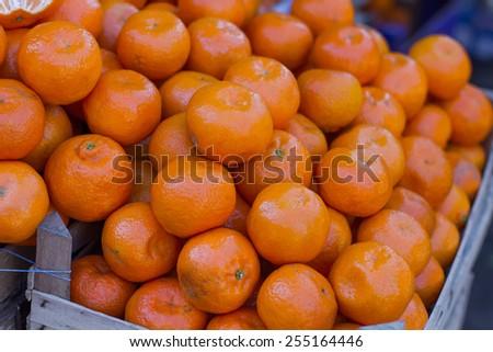 Fresh Tangerines Heap on the market. - stock photo