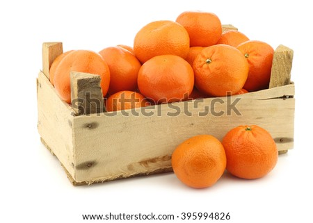 fresh tangerines in a wooden crate on a white background - stock photo