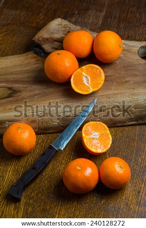 Fresh tangerines on wooden table - stock photo