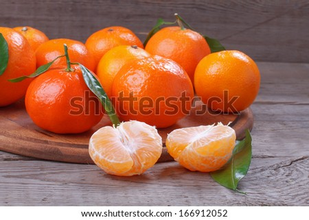 Fresh tangerines over wooden table