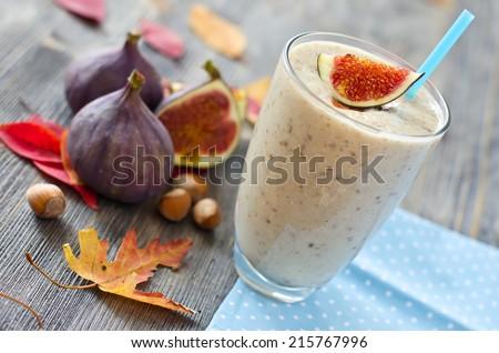 Fresh tasty beverage in autumn wooden background - stock photo