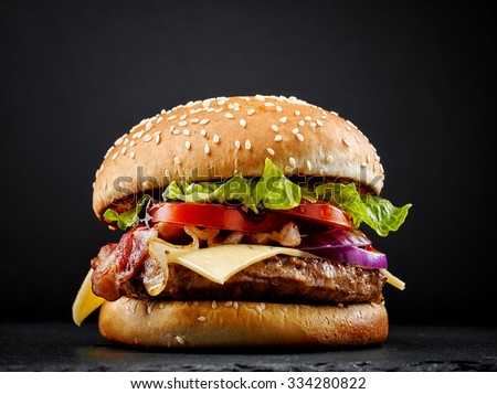fresh tasty burger on black background