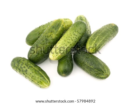 Fresh tasty cucumbers on white background