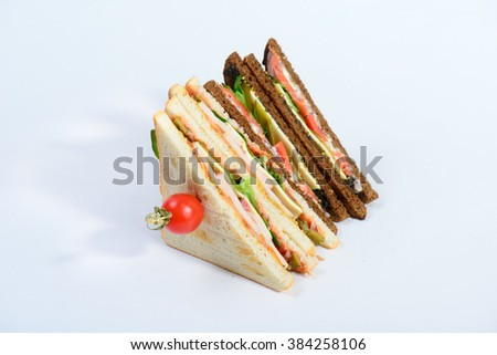 fresh tasty sandwich with ham and greens isolated on white