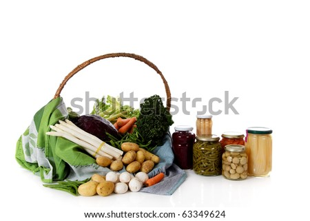Fresh tasty vegetables versus canned vegetables. Healthy eating concept. Studio shot. White background. Copy space. - stock photo