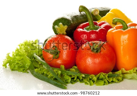 Fresh tasty vegetables with water drops isolated on white background