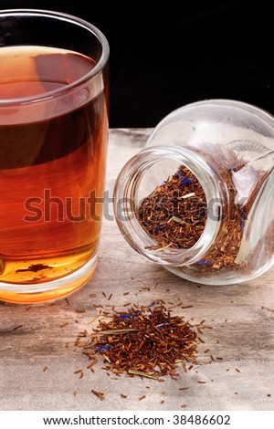 fresh tea and dry tea on the wooden background