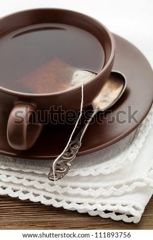 Fresh tea in brown cup, selective focus - stock photo