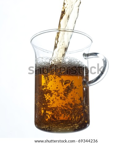 Fresh tea pouring on the glass , white background