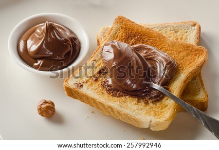 Fresh Toast with chocolate spread for a sweet breakfast. - stock photo