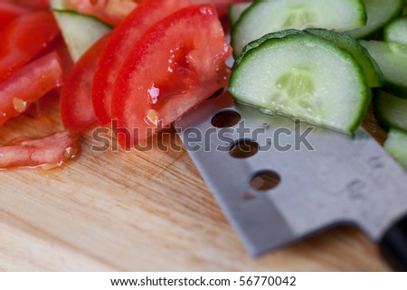 fresh tomato and cucumber on the chopping board