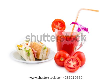 Fresh tomato juice and sandwiches with various fillings at a plate isolated on white background - stock photo