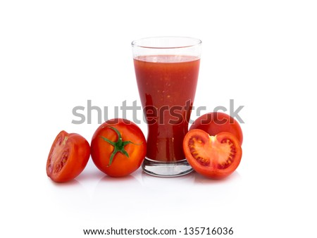 Fresh tomato juice with ripe tomatoes over white background