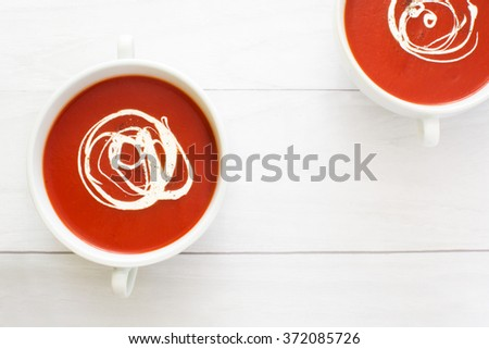 fresh tomato soup in a white bowl - stock photo