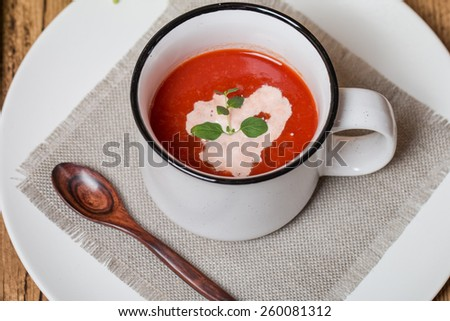 fresh tomato soup in a white bowl with ingredients - stock photo