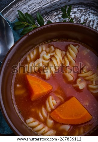 Fresh tomato soup in stoneware bowl - stock photo