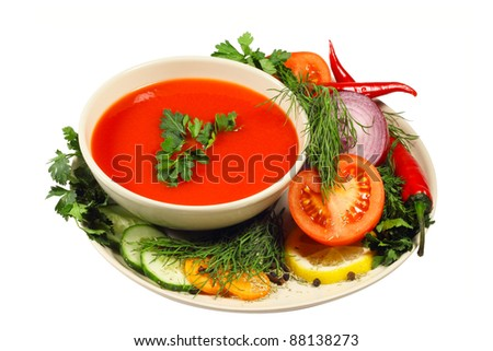 Fresh tomato soup with different vegetables isolated on white - stock photo