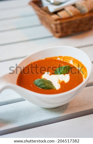 Fresh tomato soup with sour cream - stock photo