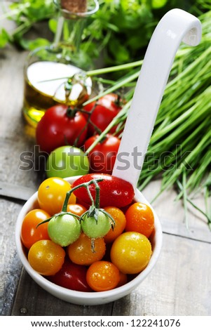 fresh tomatoes and herbs on a wooden table - stock photo