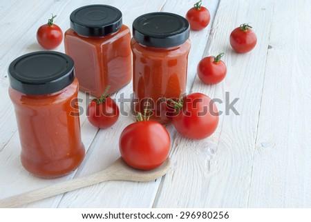 Fresh tomatoes and tomato sauce  - stock photo