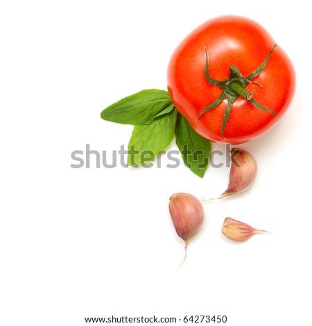 Fresh tomatoes, basil and garlic isolated on white background - stock photo
