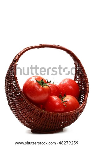 Fresh tomatoes in a basket - stock photo