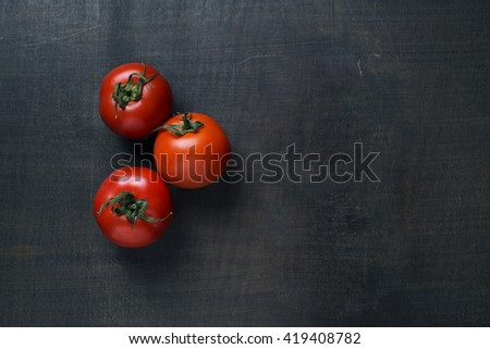 Fresh tomatoes ingredients on wooden background - stock photo