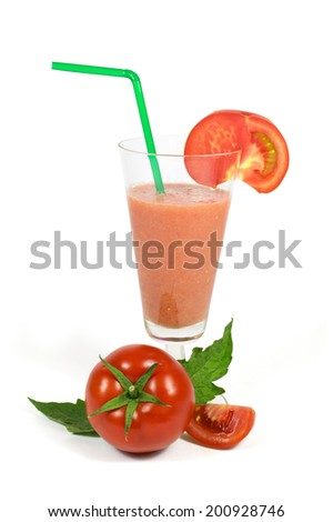 Fresh tomatoes juice in glass cup with green tube and sliced tomatoes isolated on white background