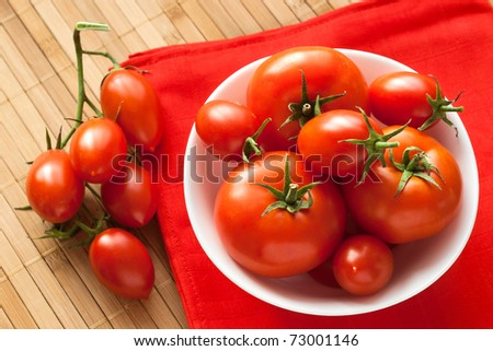 fresh tomatoes on red napkin from above