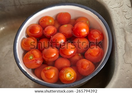 Fresh tomatoes on the bowl, ready to be juiced - stock photo