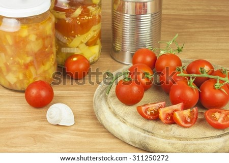 Fresh tomatoes on the kitchen table. Tomatoes on a wooden cutting board. Domestic cultivation of vegetables. Fresh organic food ready to cook. Fresh dietary ingredients. Raw vegetables to raw food. - stock photo