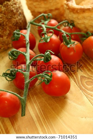 fresh tomatoes on wooden