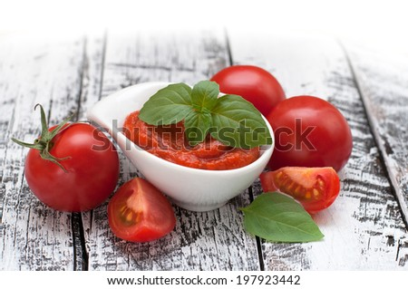 Fresh tomatoes with paste - stock photo