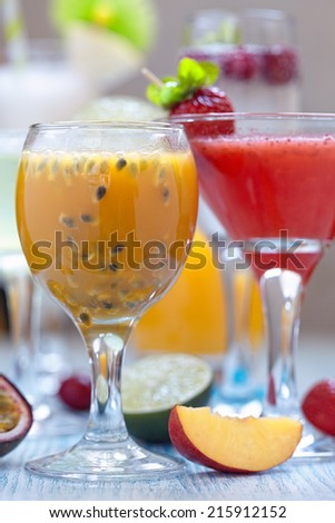 Fresh tropical cocktail with orange, peach and passion fruit - stock photo