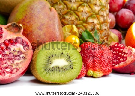 fresh tropical fruits against white background - stock photo
