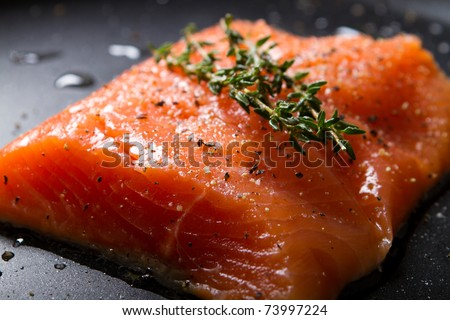 fresh trout fillet on a frying pan - stock photo