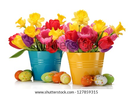 Fresh tulips, daffodils and easter eggs on white background