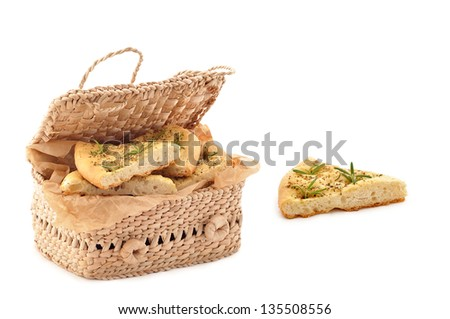 Fresh Typical italian bread slices with rosemary in basket - stock photo