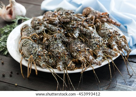 Fresh uncooked Spiny lobsters, raw group of crayfish ready for cooking, selective focus and shallow dof. - stock photo