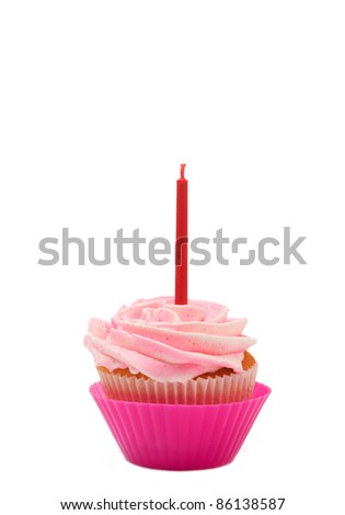 Fresh vanilla cupcake with rose buttercream icing and birthday candle on white background - stock photo