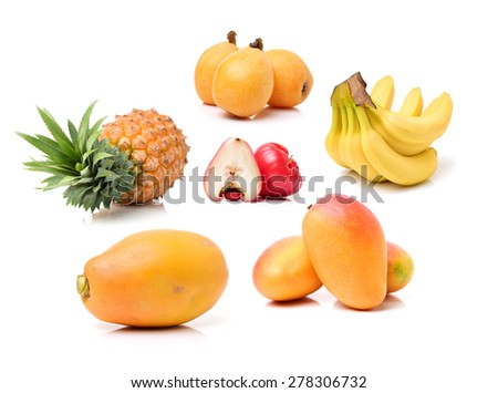 Fresh variety tropical fruits on white background - stock photo