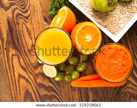 Fresh vegetable and fruits juices on wood  - stock photo
