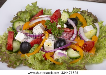 Fresh vegetable greek salad on the table. Close up - stock photo