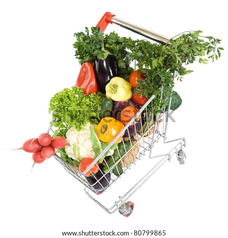 Fresh vegetable groceries in shopping cart - isolated