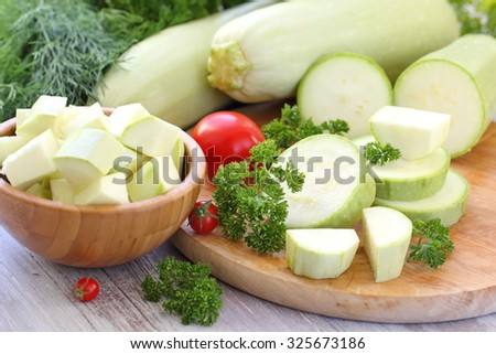 Fresh vegetable marrow and other vegetables for cooking - stock photo