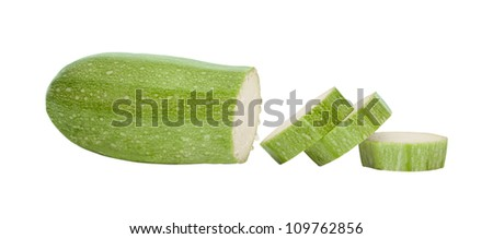 Fresh vegetable marrow cut on a part on a white background close up.