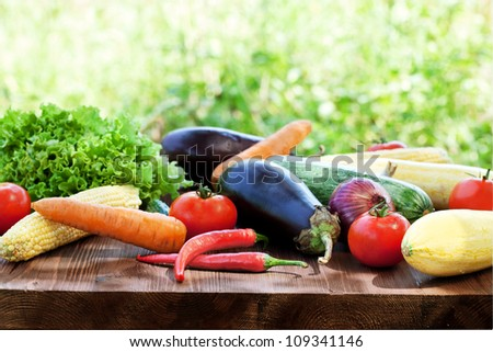 Fresh vegetable on a wooden table - stock photo
