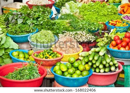 Fresh vegetable on street market in Ho Chi Minh, Vietnam.  - stock photo
